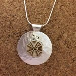 hammered pendant with gold plated spiral