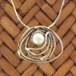 abstract pendant with pearl necklace by Tamir Zuman