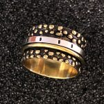 brass dot spinner ring by Ritual Jewelry