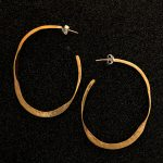 Flat hammered hoops by Ritual Jewelry
