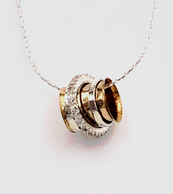 Gold-Filled Spinner Necklace from Ithil Metalworks