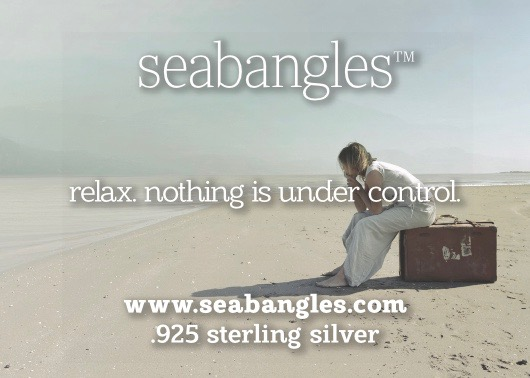 relax nothing is under control woman sitting on suitcase on beach seabangles image